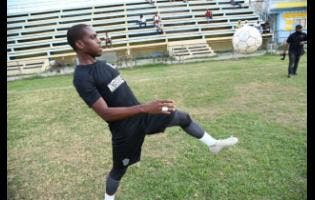 Waterhouse midfielder Tremaine Stewart engages in a bout of 'keepie uppies' during a training session at the Drewsland Stadium on Wednesday.