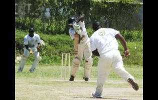 Allsides captain Oral Rankine (left) stands resolute in defence during a Zone C game in the Social Development Commission/Wray and Nephew National Community Twenty20 Cricket game against Broughton Cricket Club at Bounty Hall, Trelawny, in the 2011 season.