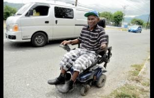 Brenton Orr uses his wheelchair to travel around the Corporate Area.