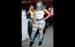 Dancer DaniiBoo stands out with her blue hair during Floss 360 Hardball Sound Clash at St Lucia car park in New Kingston recently.
