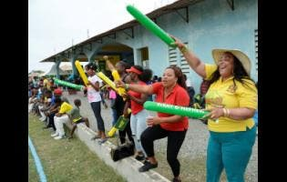 Johnson Mountain supporters in a jubilant mood after their team won the Social Development Corporation (SDC) T/20 Cricket tournament at Goodyear Oval in St Thomas yesterday.