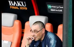 Chelsea head coach Maurizio Sarri smokes a cigarette on the bench after winning the Europa League Final between Chelsea and Arsenal at the Olympic stadium in Baku, Azerbaijan.