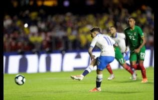 Brazil's Phlippe Coutinho scores from the penalty spot his side's opening goal during a Copa America Group A  match against Bolivia at the Morumbi stadium in Sao Paulo, Brazil, last Friday.