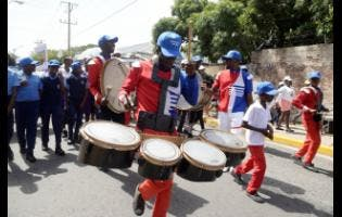 Drummers from the Micheal Steppers Marching Band take part in the MLSS (Ministry of Labour and Social Security) road march against child labour. The march started on the grounds of the MLSS and ended at the St William Grant Park in downtown Kingston, on June 12.