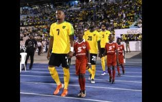 Leon Bailey walks out of the McDonald Tunnel at the National Stadium on Monday night to make his senior debut for Jamaica in the Reggae Boyz opening Gold Cup match against Honduras.