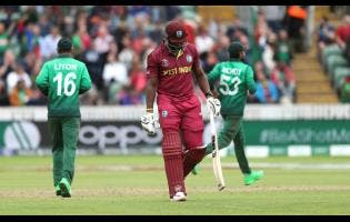 West Indies' Andre Russell walks off the field after being dismissed during the Cricket World Cup match against Bangladesh.