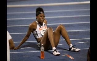 Dannielle Williams ponders after she was judged to have false-started in the 100m hurdles for women at the JAAA National Senior Championships yesterday.
