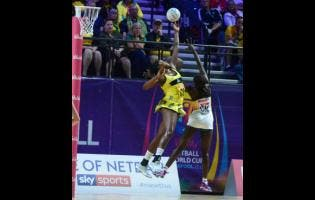Jhaniele Fowler goes high for a lob pass over South Africa's goalkeeper, Phumza Maweni, as Jamaica loses their first match of  the 2019 Vitality Netball World Cup.