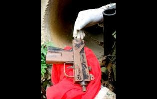 The Uzi sub-machine gun which was seized during an operation carried out in Unity Hall, St James last Saturday.