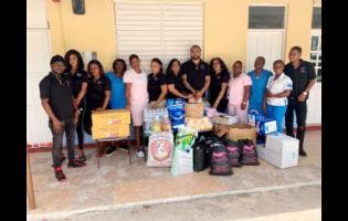 Staff of the St Ann Infirmary were happy to receive the donations.
