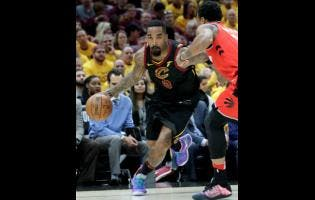 In this May 7, 2018 file photo, Cleveland Cavaliers' J.R. Smith (left) drives on Toronto Raptors' DeMar DeRozan in the first half of Game 4 of an NBA basketball second-round play-off series in Cleveland.