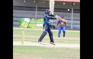 Johnson Mountain captain Gavaskar Malachi plays a shot over point during his innings of 72 not out against Orange in the opening quarter-final match of the SDC/Wray and Nephew National Community T20 cricket competition at Chedwin Park last Saturday.
