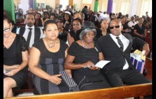 Family members of the late Neville Croasdale at his funeral, held at the William Knibb Baptist Church yesterday.