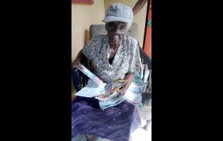 Anita Lawrence, 90, is known as the 'Funeral Woman' in his home town of Bethel Town, Westmoreland.