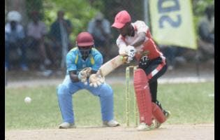 Emeki Jones (right), of White River, in action against Links United at the Three Hills Oval in St Mary in the SDC/Wray and Nephew National T20 competition on Sunday.