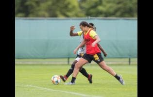Jamaica midfielder Toriana Patterson (front) attempts to force teammate Tiffany Cameron to give up possession during a Reggae Girlz training session at the FIFA Women's World Cup at the Centre de Vie Raymond Kopa in Reims, France on Monday June 10. Gladstone Taylor/Multimedia Photo Editor