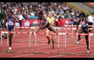 Jamaica's Danielle Williams (centre) competes on her way to winning the women's 100m hurdles during the Muller Grand Prix Diamond League event in Birmingham yesterday.