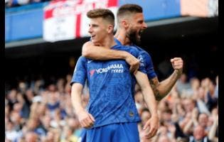 Chelsea's Mason Mount celebrates with Olivier Giroud (right) after scoring the opening goal during the English Premier League match between Chelsea and Leicester City at Stamford Bridge stadium yesterday.