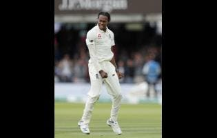 England's Jofra Archer celebrates after taking the wicket of Australia's David Warner.