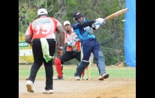 Johnson Mountain's Gavaskar Malachi hits a six against the White River Rebels during the third-place play-offs of the SDC/Wray & Nephew National Community T20 Cricket competition.