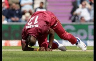 West Indies' Andre Russell gets up before walking off the field of play with an injury after bowling during the Cricket World Cup match between England and West Indies at the Hampshire Bowl in Southampton, England, on June 14, 2019.
