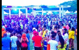 A section of the crowd at Sandz Offshore, held at Caymanas Polo Club last Sunday.