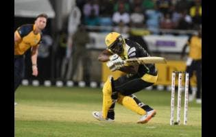 Jamaica Tallawahs batsman Andre Russell is floored by a short ball from St Lucia Zouks' Hardus Viljoen.