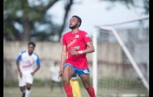 Dunbeholden's Dean-Andre Thomas celebrates after scoring a penalty against Portmore United yesterday. Dunbeholden won the match 1-0.