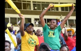 Supporters of the Jamaica Tallawahs celebrate their first win of the 2019 Caribbean Premier League T/20 campaign after they defeated the  Barbados Trident  at Sabina Park on Sunday.