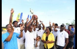 Members of the Longville Park cricket team celebrating their victory in the NHT Cream of the Crop T20 competition on Sunday.