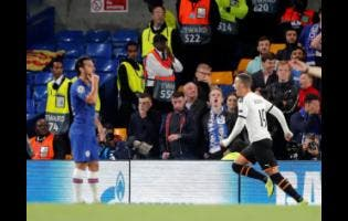 Valencia's Rodrigo Moreno, (right) celebrates after scoring his side's opening goal during the Champions League Group H match against Chelsea at Stamford Bridge stadium in London yesterday.