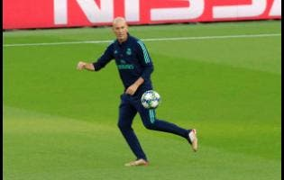 Real Madrid's coach Zinedine Zidane plays the ball during a training session at Stade des Princes stadium in Paris yesterday.