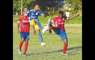 Hydel High's Delroy Trowers (centre) brings the ball down while under pressure from Camperdown High's Cafu Washington (left) and Jeovanni Laing during their ISSA/Digicel Manning Cup game at the Caymanas Field on Friday, September 13.