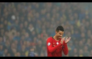 Portugal's Cristiano Ronaldo applauds during group B qualifying  match between Ukraine and Portugal at the Olympiyskiy stadium in Kyiv, Ukraine, yesterday.