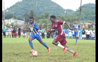 St Elizabeth Technical's (STETHS) Mushtaq Christopher  (left) and Maggotty High's  Rohan Palmer battle for the ball during an ISSA/WATA daCosta Cup Group E match at Appleton Sports Complex earlier this month.