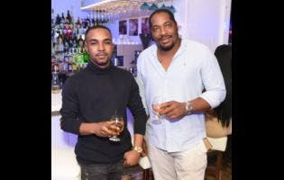 Shane Irving (left) and Kenny Johnson took time out to acknowledge our camera in between sips of cognac.