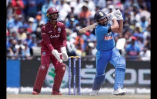 Windies wicketkeeper Nicholas Pooran (left) looks on as India's Rohit Sharma is dismissed during a Twenty20 International match in Lauderhill, Florida, on Saturday, August 3, 2019.