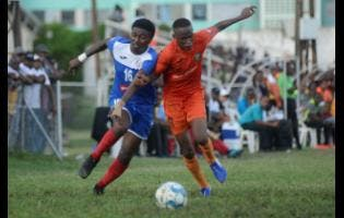 TivoliGardens' Trayvon Reid (right) challenges Roberto Johnson of Portmore United for the ball during their RSPL match at the Edward Seaga Sports Complex yesterday.
