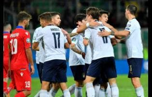 Italy players celebrate after their teammate Nicolo Zaniolo scored their side's fifth goal during a Group J qualifying match against Armenia at the Renzo Barbera stadium in Palermo, Italy, yesterday.