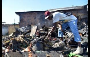 Delroy McFarlane lost all his goods in the fire that destroyed the May Pen Market in Clarendon on Sunday.