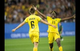Havana Solaun celebrates with Khadija Shaw (right) moments after scoring Jamaica's first in the women's World Cup football against Australia at the 2019 FIFA Women's World Cup at Stade des Alpes in Grenoble, France on  June 18.