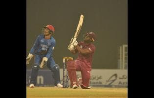 Opener Evin Lewis (right) smashes a big six during his 68 off 41 balls during the Windies 30 run win over Afghanistan in their Twenty20 International match at the Atal Bihari Vajpayee International Stadium in Lucknow, India, on    November 14.
