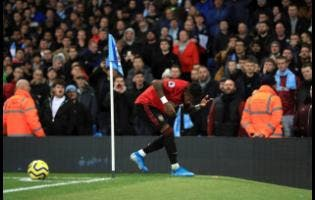 Manchester United's Fred reacts after objects are thrown at him during the English Premier League match at the Etihad Stadium, Manchester, England, on Saturday.