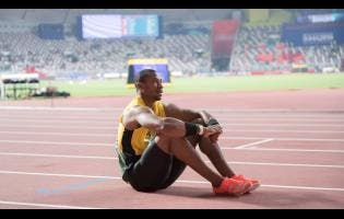 Yohan Blake, with a look of dejection, sits on the track after his disappointing fifth-place finish in the final of the men's 100m at the World Athletics Championships on September 28, 2019.