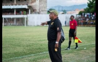 Lenny Hyde instructs Falmouth United's players from the sideline during their Western Confederation match against Montego Bay United at Jarrett Park on Sunday.