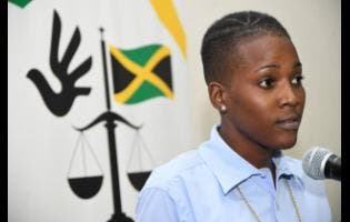 Moya Blackwood speaks to members of the media during  the Jamaicans For Justice press briefing on incarcerated children at the Spanish Court Hotel yesterday.