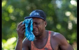 Rayon Duncan is overcome with grief as he remembers his four friends who were murdered.