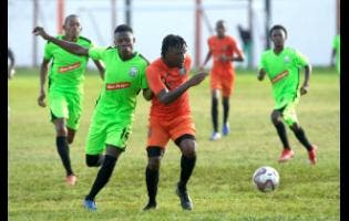 Tivoli Gardens' Jermaine Johnson dribbles away from from Molynes United's Sergeni Frankson during their RSPL match at the Edward Seaga Sports Complex on Wednesday.