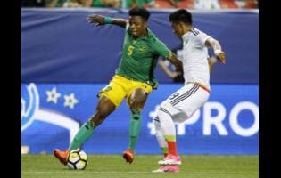 Alvas Powell (left) in action for Jamaica during the 2017 Concacaf Gold Cup.