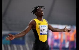 Tajay Gayle celebrates his 8.69 metres gold medal leap in the men's long jump finals at the 2019 World  Athletics Championships